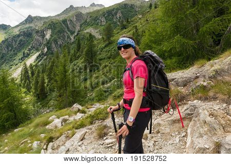 Happy female trekker posing. Active lifestyle in the mountains.