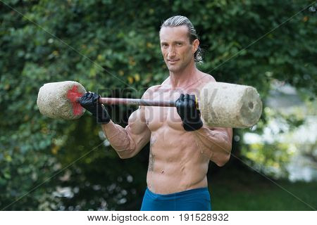 Man Doing Exercise For Biceps Outdoors Workout