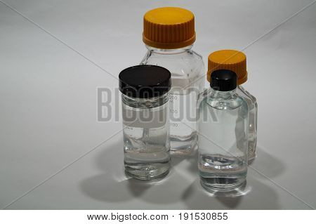 Bottles For A Laboratory Filled With Clear Fluid
