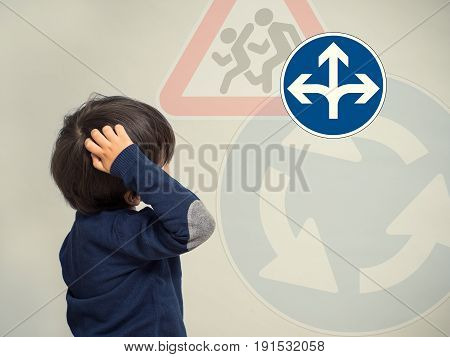Little Boy Looks At Traffic Signs