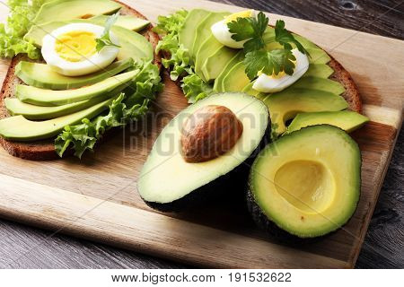 Sandwich With Avocado And Poached Egg - Healthy Breakfast Concept