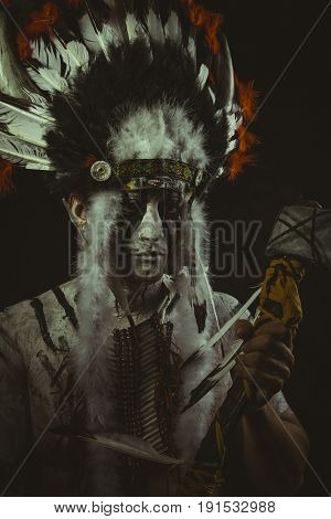 Culture Aboriginal, American Indian with plume of feathers, ax and war paintings