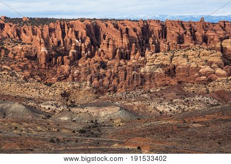 Mesa with red rock formation at Arches National Park Utah.