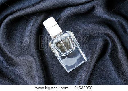 Perfume bottle on cloth