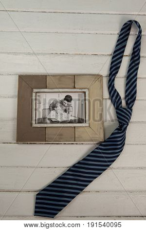 High angle view of necktie by photograph on table