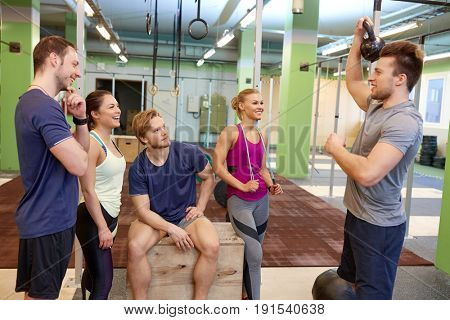 fitness, sport, exercising and healthy lifestyle concept - group of happy people with skipping rope and medicine ball in gym
