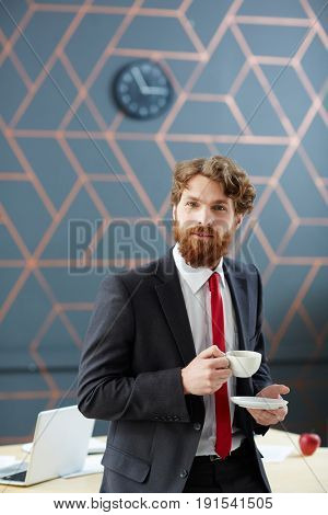 Caucasian business leader with cup of tea