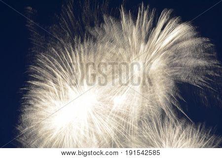 White  fireworks in the dark night in long-term