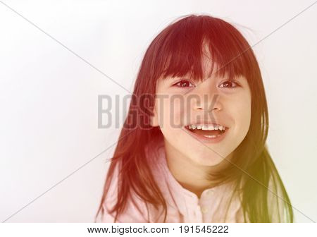 Young girl making facial expression