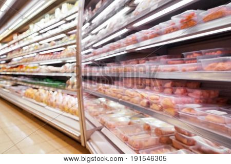 Blurred view of fresh meat products in butcher shop