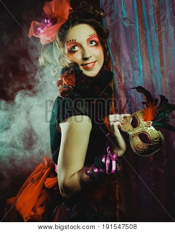 Fashion shot of woman in doll style. Creative make-up.Fantasy dress.
