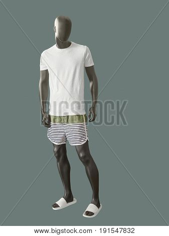 Full-length male mannequin dressed in casual summer clothes isolated on gray background. No brand names or copyright objects.