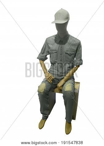 Sitting male mannequin isolated on white background. No brand names or copyright objects.