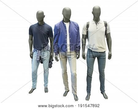 Three man mannequins dressed in casual clothes isolated on white background. No brand names or copyright objects.