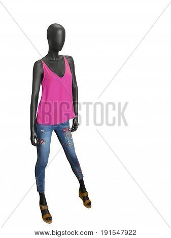 Full-length female mannequin dressed in vest and blue jeans isolated on white background. No brand names or copyright objects.