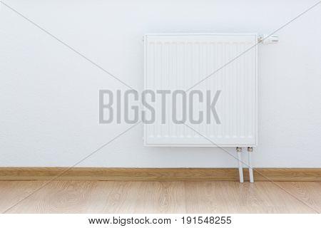 heating radiator against white wall