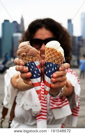 Young woman with American ice cream in hands