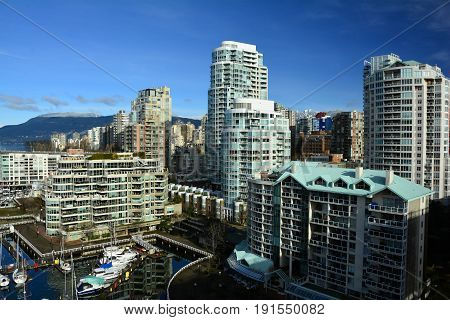 Vancouver BC, Canada, February 20th 2017.The sky oine of False Creek in Vancouver makes for high end urban real estate.Remember it costs nothing to look.