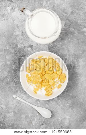 Cup Of Cornflakes With Milk On A Light Background. Top View. Food Background