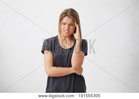 Shot View Of Troubled Exhausted Woman With Sorrorful And Haggard Look Frowning Face Holding Hand On