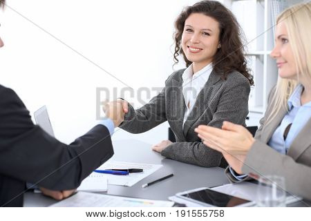 Business people shaking hands at meeting. Business people concept