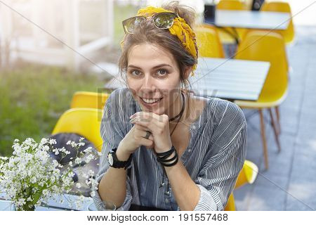 People, Rest, Lifestyle Concept. Beautiful Smiling Woman With Sunglasses And Headband On Head Wearin