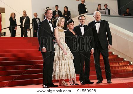 John Doman, Joaquin Phoenix, Ekaterina Samsonov, Lynne Ramsay, Alex Manette attend the 'You Were Never Really Here' screening during the  Film Festival at Palais on May 27, 2017 in Cannes, France