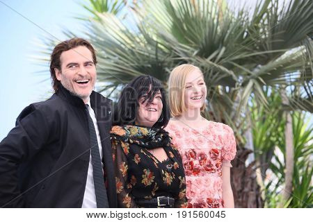 Joaquin Phoenix,  Lynne Ramsay,  Ekaterina Samsonov attend the 'You Were Never Really Here' photocall during the 70th  Cannes Film Festival at Palais des Festivals on May 27, 2017 in Cannes, France.