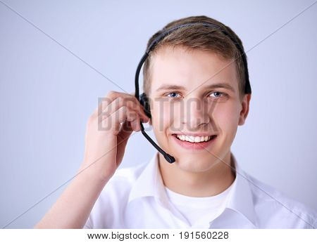 Call center male operator on gray background