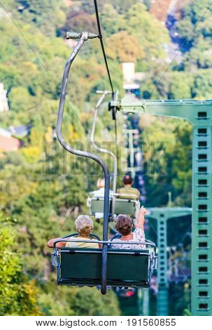 Photo of elderly women on chairlift in the mountains