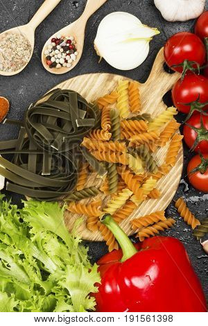 Raw Pasta Of Tagliatelle With Spinach And Fusilli Pasta With Spinach And Tomatoes, And Ingredients F