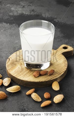 Vegan Almond Milk In Glass On A Dark Background. Non-dairy Milk