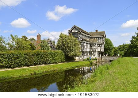 Congleton; Cheshire; England United Kingdom - June 17 2017 : Little Moreton Hall a moated half-timbered manor house built in the 16th century