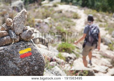 Tourist signs on trail in mountains, Tourist signage with running man