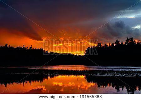Beautiful sunset on the river Chirko-Kem. Karelia, Russia