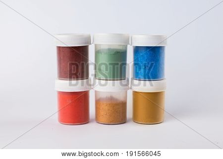 pigments on a white background, powdered pigment, a bank