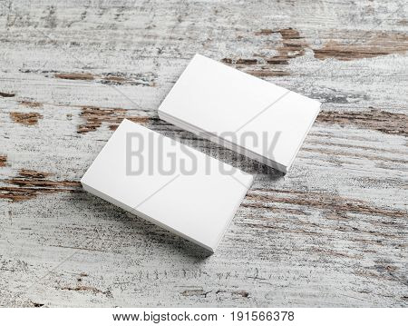Photo of blank business cards on vintage wood floor background. Template for your design.
