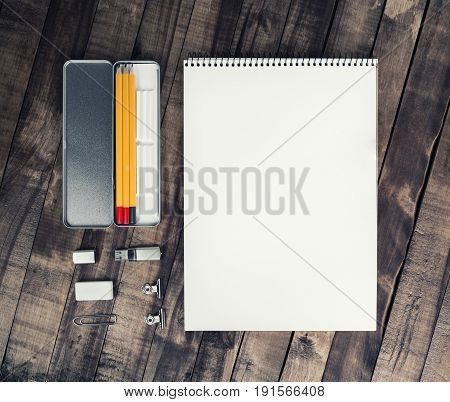 Blank stationery set. Album pencil case pencil flash drive clip and eraser on vintage wooden background. Template for placing your design. Responsive design mockup.