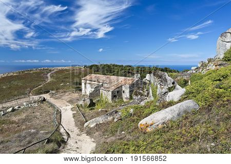 View of the abandoned small Hermitage of Sao Saturnino in the Peninha Sanctuary complex in the Sintra's Mountain range near Lisbon Portugal