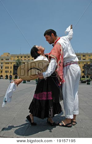Marinera dancers in front of colonial buildings in Lima Peru