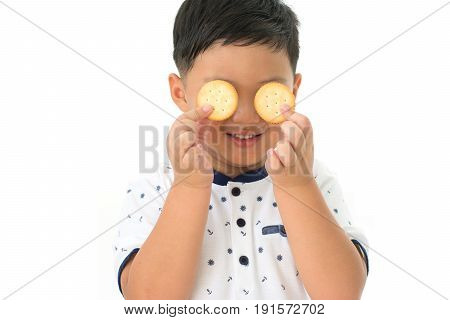 Little boy shutting eye with cookie isolated on white background