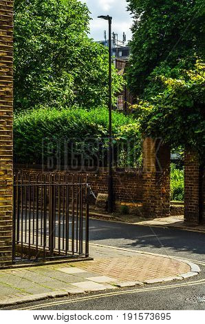 Typical Old English Buildings, Low Brick Buildings Across A Narrow Street, Interesting Old London Ar