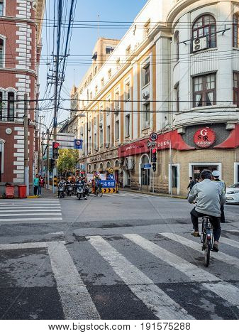 Shanghai, China - Nov 4, 2016: Along Sichuan Road Middle. Cyclists and pedestrians. Street photography.