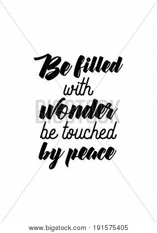 Isolated calligraphy on white background. Quote about winter and Christmas. Be filled with wonder, be touched by peace.