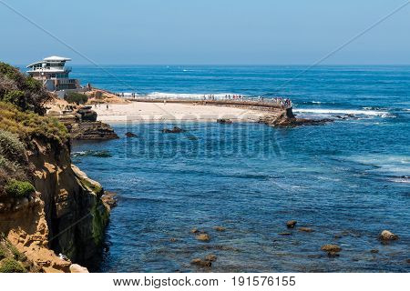 LA JOLLA, CALIFORNIA - JUNE 16, 2017:  The La Jolla Children's Pool, along with the newly constructed lifeguard tower and adjacent cliffs in the county of San Diego.