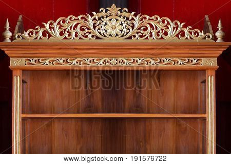 Wooden vintage shelf with golden ancient craving design pattern background for product display template