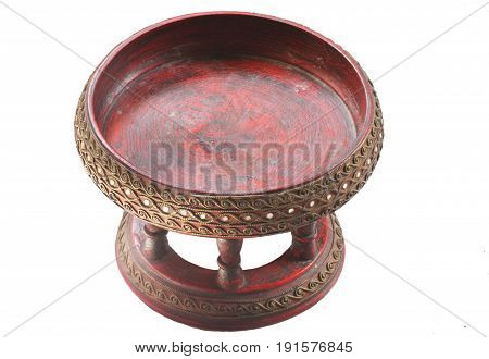 ancient art traditional northern thai (Chiang mai) food tray, made from wood and painted with red and gold leaf, called Khantoke, isolated with white backgrounds