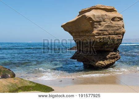 Eroded lone rock formation at the Children's Pool in La Jolla, California.