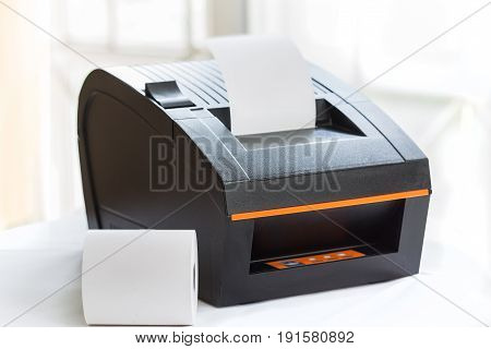 Office equipment A point of sale receipt printer printing a receipt
