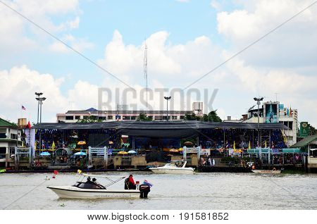 Thai people and travelers foregner join and cheer athlete rowing boat in Long boat Racing at Chaopraya river on November 8 2015 in Nonthaburi Thailand